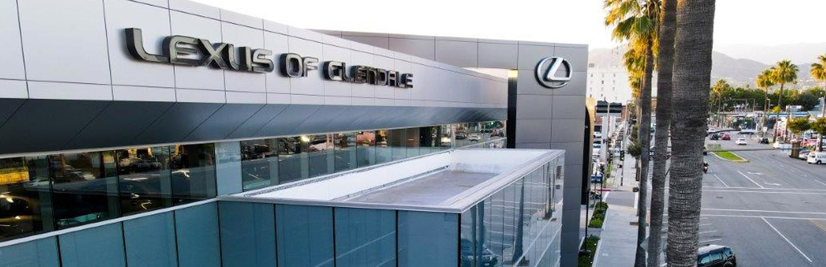 exterior view of the Lexus of Glendale dealership with multiple lexus vehicles in front of it