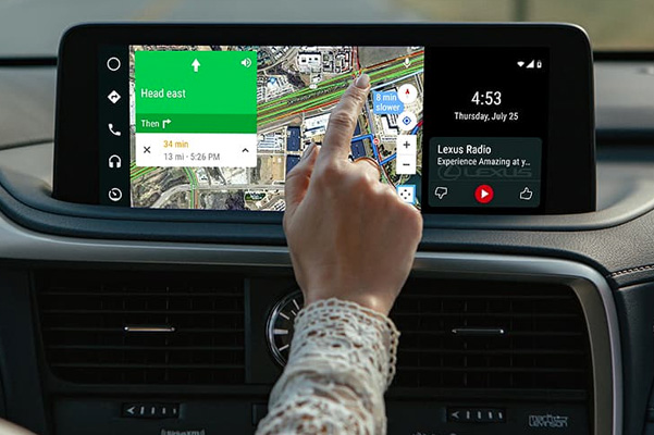 Lexus driver using touch screen on dashboard for GPS